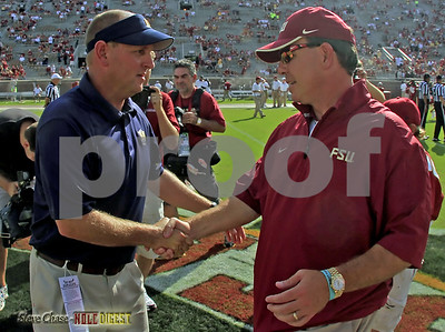 Coach Fisher & Coach Hatcher meet at mid-field prior to the game