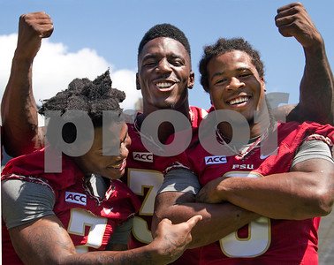 2013 Media Day began early this morning at Doak Campbell as players and coaches conducted interviews with print and digital media.  Following the interview sessions the team made their way to Bobby Bowden field for photo ops and team pictures. Running backs Mario Pender, James Wilder Jr, and Devonta Freeman having some fun prior to heading over to the Civic Center for Fan Day.