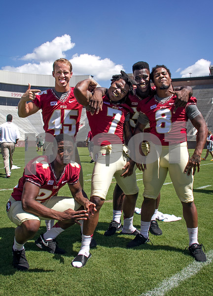 2013 Media Day began early this morning at Doak Campbell as players and coaches conducted interviews with print and digital media.  Following the interview sessions the team made their way to Bobby Bowden field for photo ops and team pictures.  RB's having a bit of fun before heading over to the Civic Center for Fan Day.  From left to right - (kneeling) Ryan Green, Will Burnham, Mario Pender, James Wilder, and Devonta Freeman.