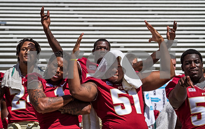 2013 Media Day began early this morning at Doak Campbell as players and coaches conducted interviews with print and digital media.  Following the interview sessions the team made their way to Bobby Bowden field for photo ops and team pictures. Players had a little bit of fun as they waited for Coach Fisher to arrive. Shown L to R are Terrance Smith, Kelvin Benjamin, Keelin Smith, Bobby Hart, and Tre Jackson.