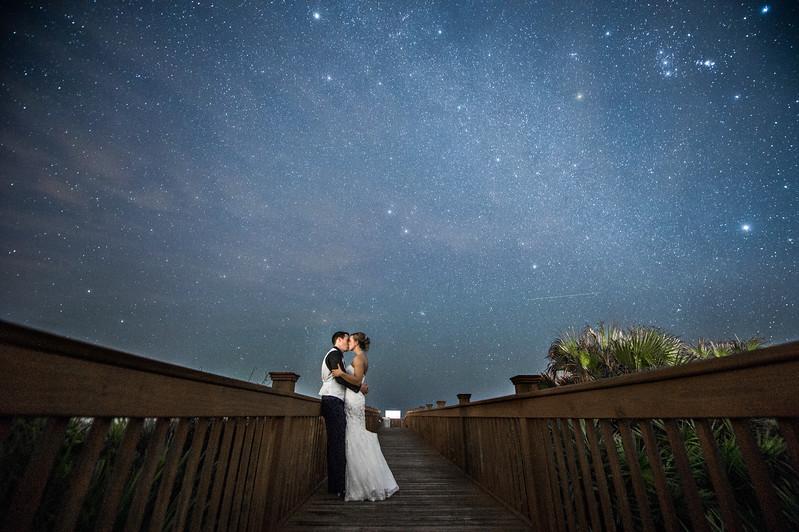 Bride and groom kissing under the milkyway stars  | Hammock Beach Resort