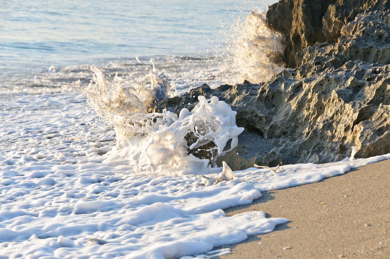 Rolling surf breaks on the beach.
