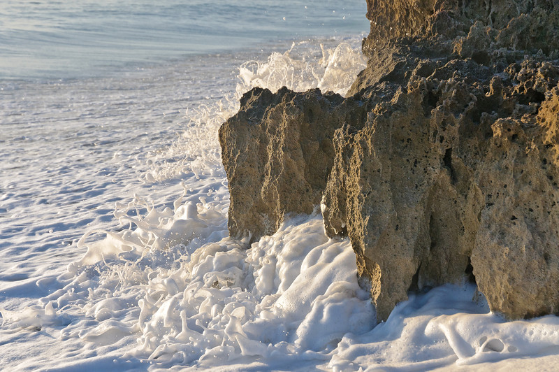 The sea  pummels the rock fortress of the beach.