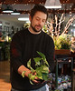 HOLLY PELCZYNSKI - BENNINGTON BANNER Ryan McDaid, owner of Endless Spring in Shaftsbury Vermont arranges a Epipremnum aureum poted plant  on Monday morning at his shop to prepare for Valentines Day.
