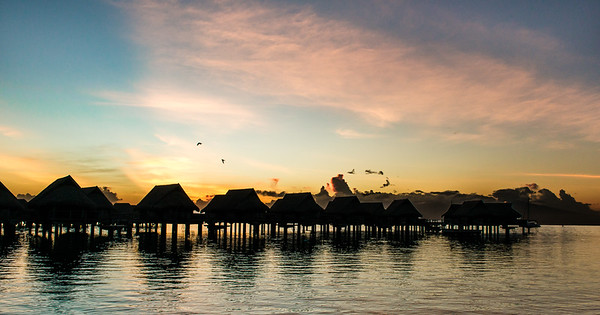 Overwater villas at dawn