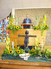 "Our Minister, Colin.<br /> Flower arrangement around the pulpit of the story of ""The Sower"""