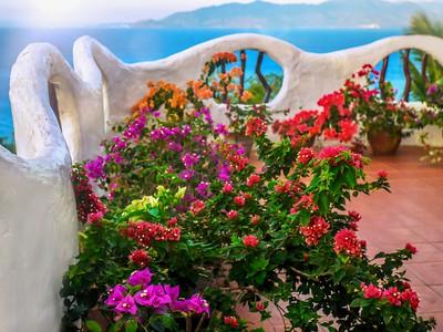 Pretty bougainvillea on a seaside balcony.