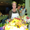 Kali Woodbridge, a member of the Power of Flowers board of directors, contemplated which blooms to off to the seniors making their individual bouquets. Photo by Mary Leach