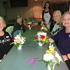 Flower arrangements finished, the seniors at the Billerica Council on Aging proudly displayed their work. Photo by Mary Leach