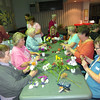 """Seniors at the Billerica Council on Aging took """"gently used"""" blooms donated to the Power of Flowers Project and assembled them into small bouquets. Photo by Mary Leach"""