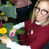 Jamie Doherty of Tewksbury, who coordinates volunteer and activity programs at the Billerica Council on Aging, tried her hand at making her own bouquet. Photo by Mary Leach