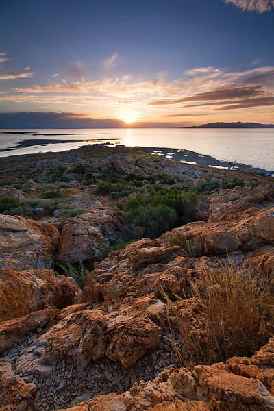 The sun sets over the Great Salt Lake at Antelope Island State Park.