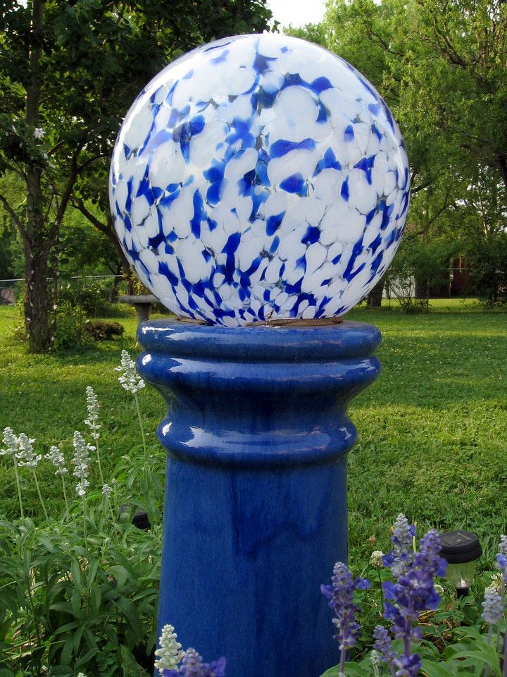 Blue and white gazing globe with blue and white salvia.