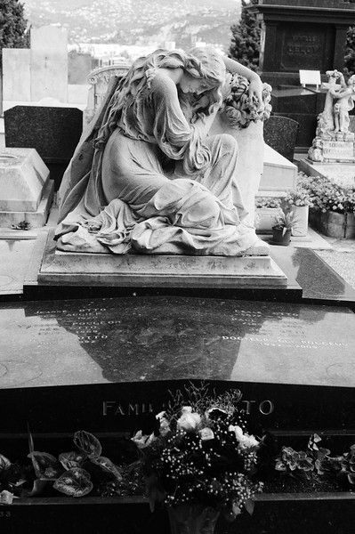 Mourning woman on tomb,<br /> Cemetery Nice, France