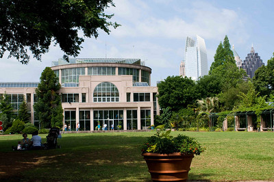 The Conservatory at the Atlanta Botanical Gardens, with the skyline of midtown in the background.