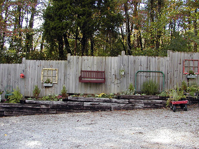I am so glad Kenny went with me on this trip. He enjoyed it almost as much as I did. He was so inspired by this hide-a-fence decorated with household items. We will be using hide-a-fence sections, old windows, and railroad ties to construct a raised bed heirloom veggie garden this Spring! It will serve the purpose of providing a veggie garden, hiding our propane tank from view, be beautiful to look at, and be one less spot to have to mow!