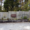 I am so glad Kenny went with me on this trip. He enjoyed it almost as much as I did. He was so inspired by this hide-a-fence decorated with household items.<br /> We will be using hide-a-fence sections, old windows, and railroad ties to construct a raised bed heirloom veggie garden this Spring!<br /> It will serve the purpose of providing a veggie garden, hiding our propane tank from view, be beautiful to look at, and be one less spot to have to mow!