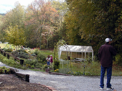 Erin's Meadow has classes they teach. Many of them are conducted out under this pavilion.  Today they were having classes to teach planting herbs and arrangements. They also had a Yoga class! Lee and another instructor are down there on the hill discussing something while Kenny looks on.
