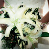 bouquet 004<br /> White & green combination: White Casablanca Lilies, baby's breath and roses with eucalyptus seeds, lily's grass and tropical greenery.