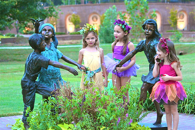 """Photofreak. March 28, 2014. This is for Godschild. Sculpture at Glencairn Park, Rock Hill, SC. The """"Wildflower Fairies"""" are my Granddaughters, Abby in yellow, Sarah in orchid and Leah in coral. I tried to find out who the sculptor is but couldn't find any info but don't they remind you of your post yesterday?"""