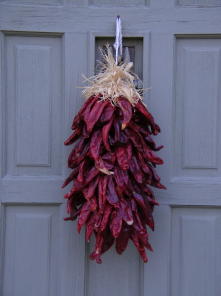 Chile Ristras Wreath<br /> Taos, New Mexico <br /> After harvest in the late summer and early fall large chiles are strung to dry so that you may have chile year round. Its is a popular belief that ristras are hung in front of your home to welcome visitors and bring you good fortune.