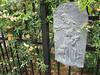 Rita Bigham's garden - statue by fence