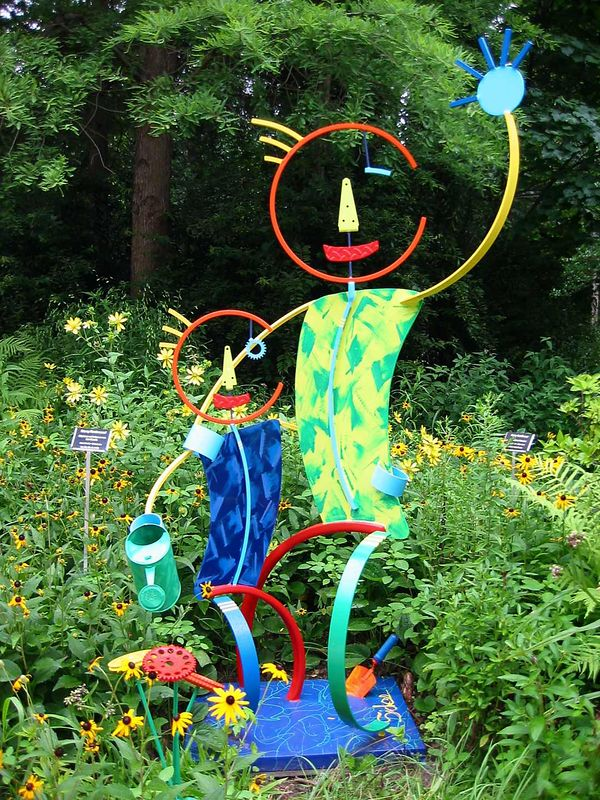 Sculpture - colorful waving adult with child