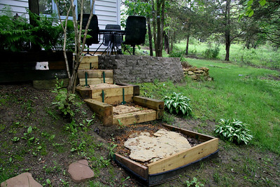 Close-up of steps from new patio addition above. More plantings will cover the wood at bottom of stairs.
