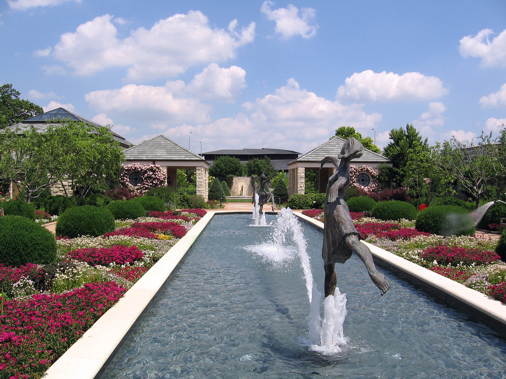 The three ladies dancing in the fountain on the west side of the garden.
