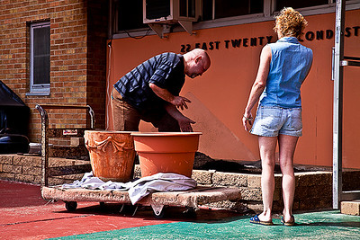 Brad and Carolyn prepare dirt for the large pots on the dolly.