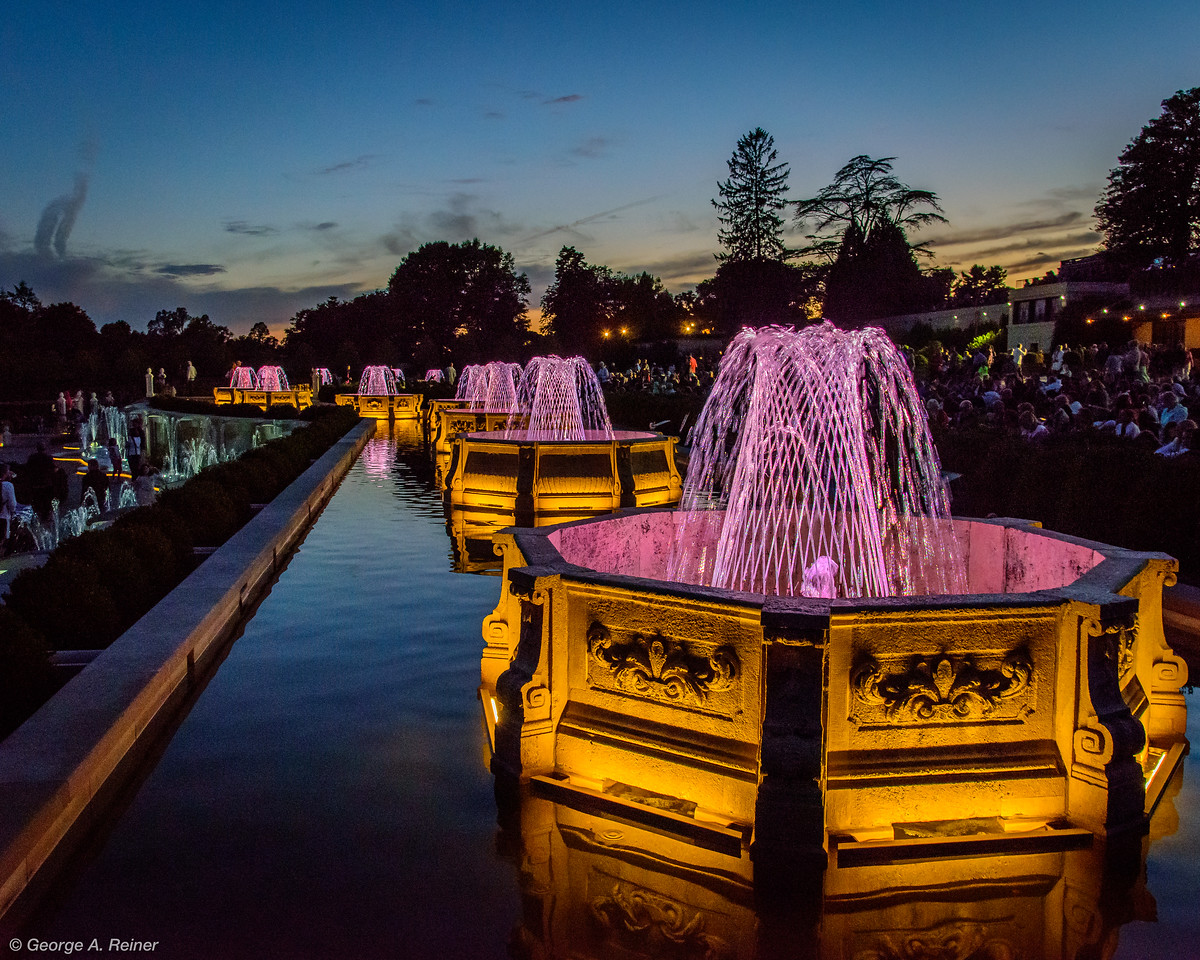 Basket weave fountains on the upper canal at night
