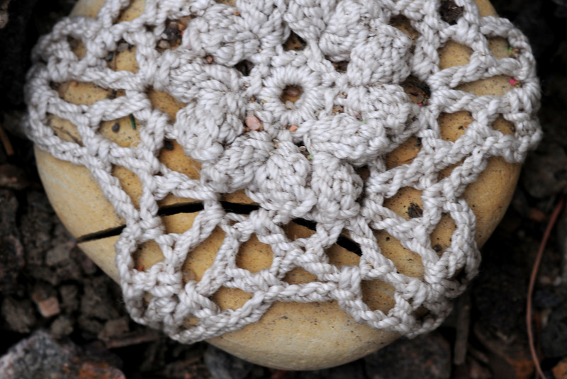The crochet holds up through the seasons better than the rock!!!