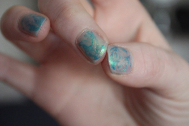 Marble swirl nail art - Max Factor Dazzling Blue, and Illamasqua Geist, under coat in Illamasqua Hemlock.