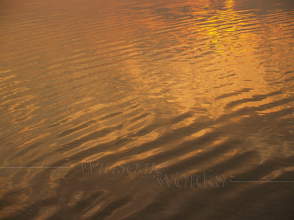 Sunrise reflections in sea, Hunting Island