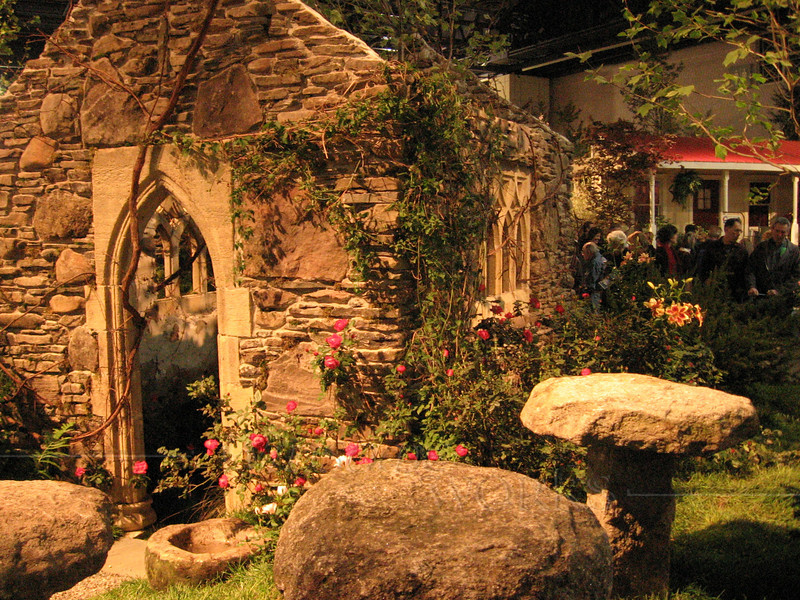 """""""Ancient"""" stone chapel built at show; vines """"growing"""" in door and  windows"""