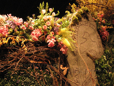 Part of arch, with Celtic runes and roses