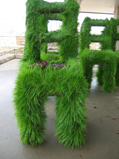 Chairs covered in grass.