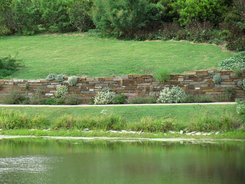 The stone wall of the Island Water Garden.