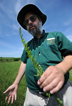 Globe/T. Rob Brown<br /> Dana Hoisington, interpretive resource specialist with Missouri State Parks, talks about non-native and invasive plant species at Prairie State Park near Liberal.