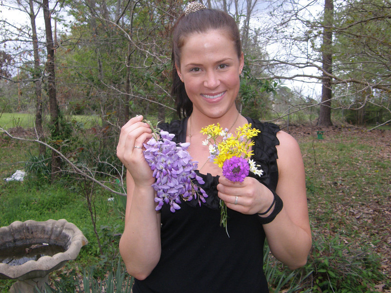 My daughter, Sarah, back from a flower picking with Dad.  The flowers are pretty, but not as pretty as Sarah!  What a beauty!