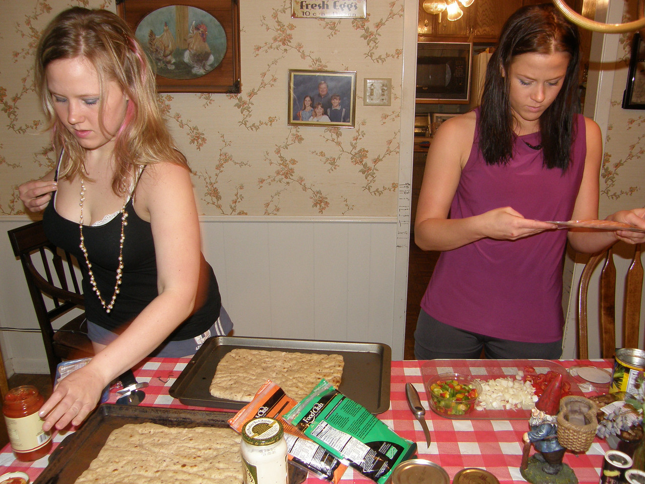 Katie and Sarah, preparing to make some pizza!
