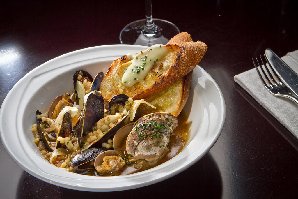 The Mussels, Clams, Fregola, Fennel and Tomato on the stove at Redd Wood Restaurant in Yountville, Calif., is seen on April 6th, 2012.