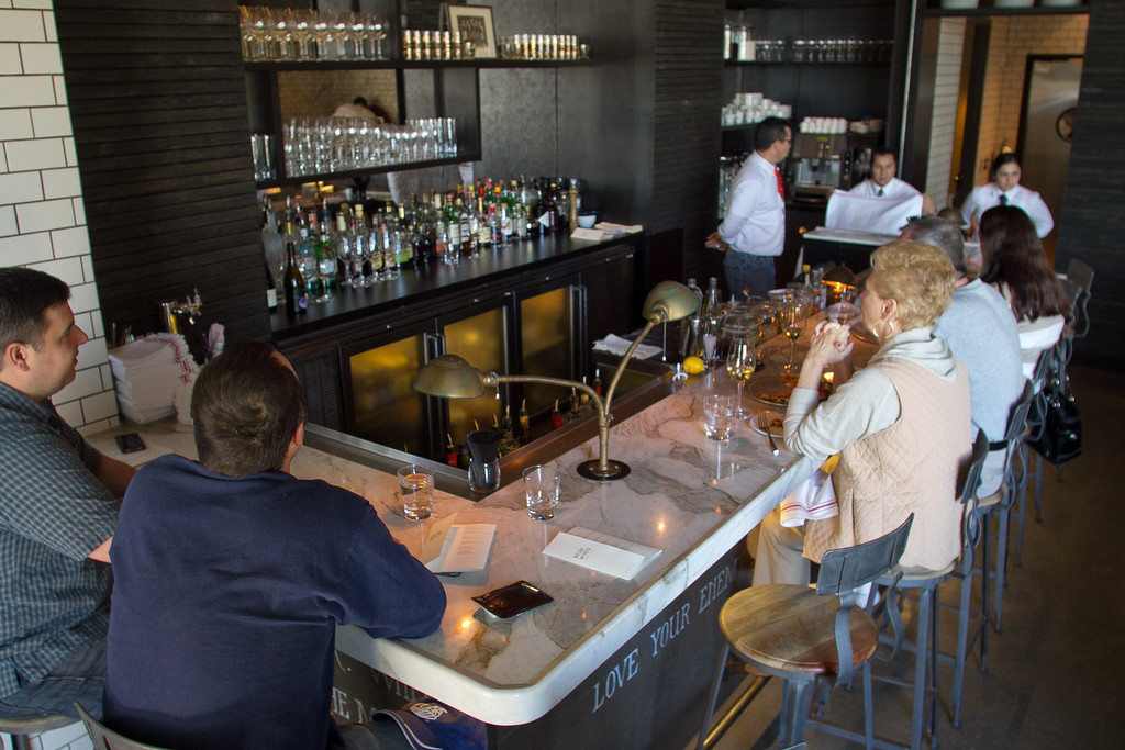 Diners enjoy lunch at the bar at Redd Wood Restaurant in Yountville, Calif.,  on April 6th, 2012.
