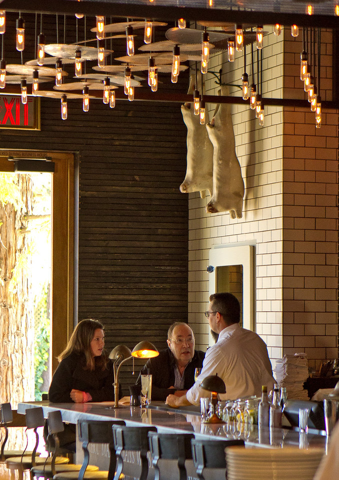 Diners enjoy lunch in the bar at Redd Wood Restaurant in Yountville, Calif., on April 6th, 2012.