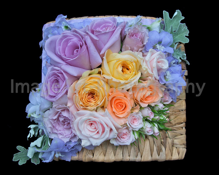 A table arrangement of roses in a basket