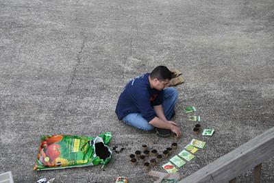 Michael planting vegetables.
