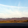 <B>Gorgeous view of Chilhowee Mountain in the evening light.<BR> Looking across the broad expanse of the Ellejoy plain at the first range of mountains in the Smokies.<BR> These green fields grow corn, wheat, rye,and  soybeans. <BR> The flood plain here is rich bottom land. <BR> It is significant from an agricultural standpoint, for its aesthetics, and historically. <BR> The Ellejoy Plain is filled with Indian arrowheads from times past. <BR> Every time this farmer turns over the fields you can see folks walking it hunting for relics.<BR> The area is popular with cyclists and the parking lot here is crowded on weekends and evenings!<BR> Area residents depend on this area for recreation in the form of fishing, swimming, riding, photography, kayaking, and painting.