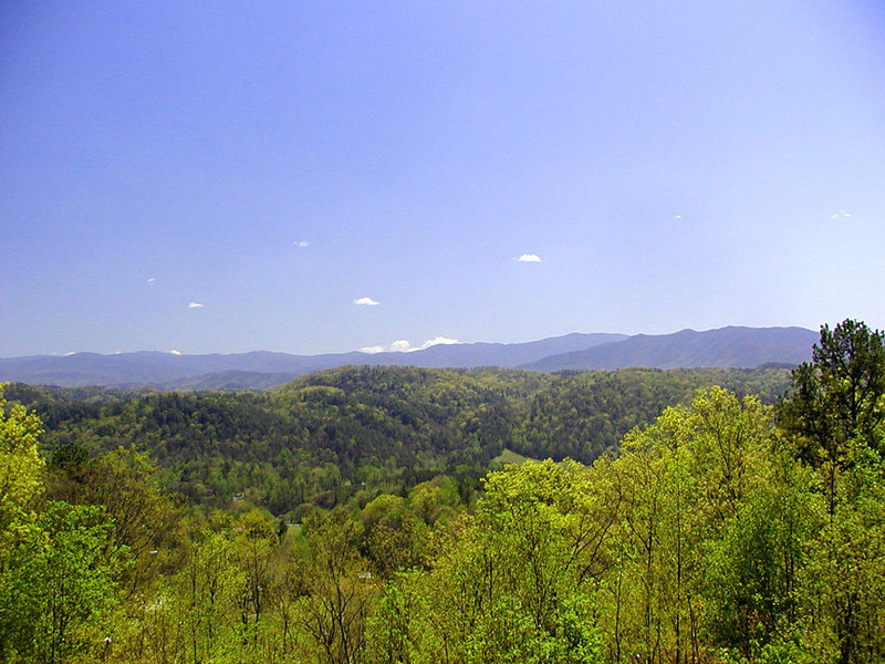 Blue skies and sunny days.  View across the Smokies from Foothills parkway west.<br /> There are numerous places along Foothills Parkway West section to see both toward the Smokies, West Millers Cove, and toward the opposite direction toward Maryville and across the foothills of Blount County.