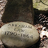 Grave marker for Abraham Law atop a knoll in White Oak Sinks.<br /> You could come here many times over and miss this quiet resting place for this pioneer man.<br /> GSMNP TN 3/09