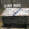Spring house with snowy roof sits by the Fittified Spring.<br /> GSMNP TN 4/09